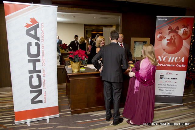 Alison Hogan and Stephen Turner welcome NCHCA members to the gala.
