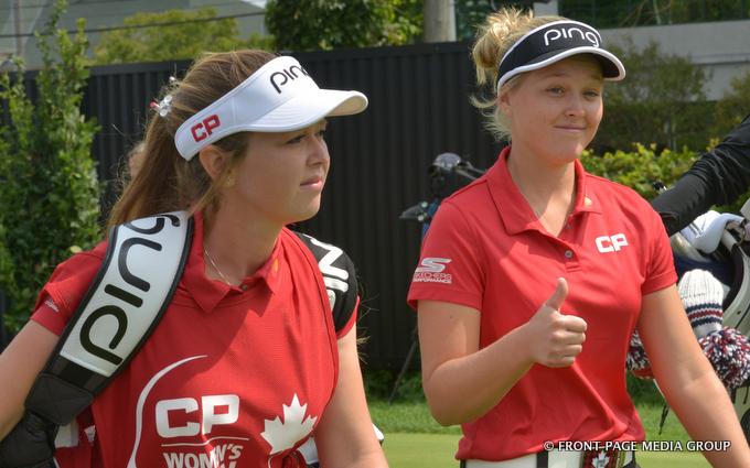 Bittany(L) and Brooke Henderson sticking around for weekend action.